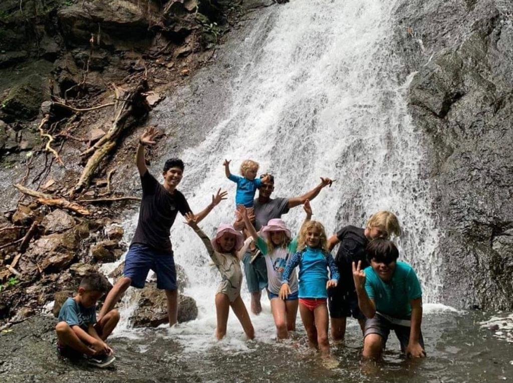 kids at the waterfall